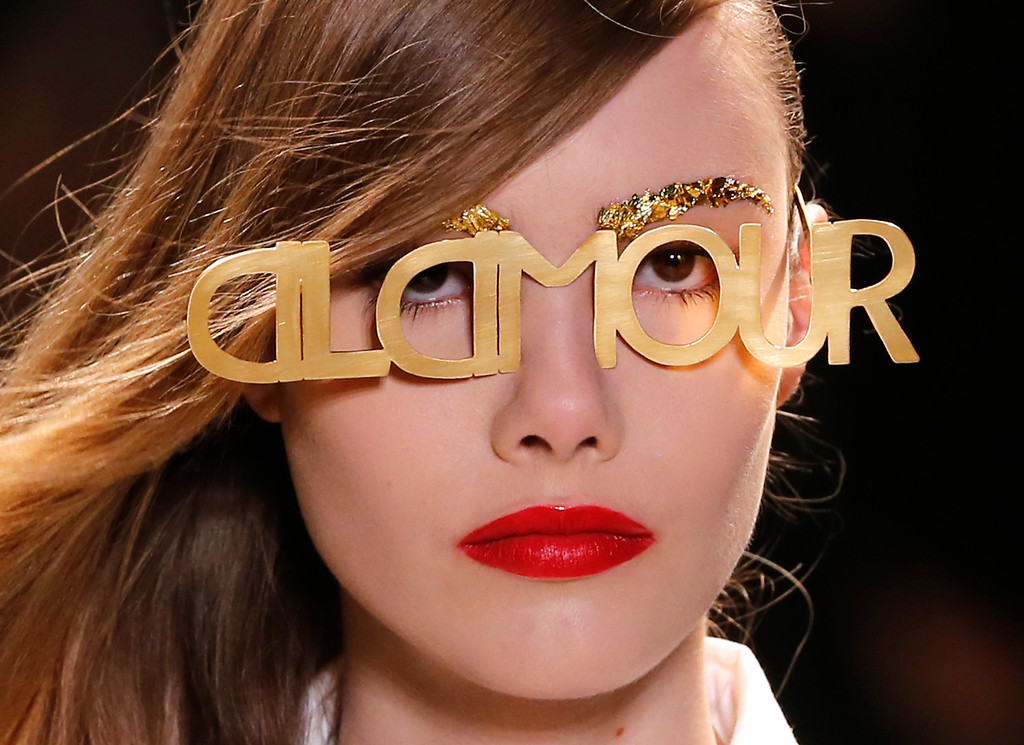 Description of . A model wears glasses for Jean-Charles de Castelbajac's ready-to-wear Spring/Summer 2014 fashion collection, presented in Paris, Tuesday, Oct.1, 2013. (AP Photo/Jacques Brinon)