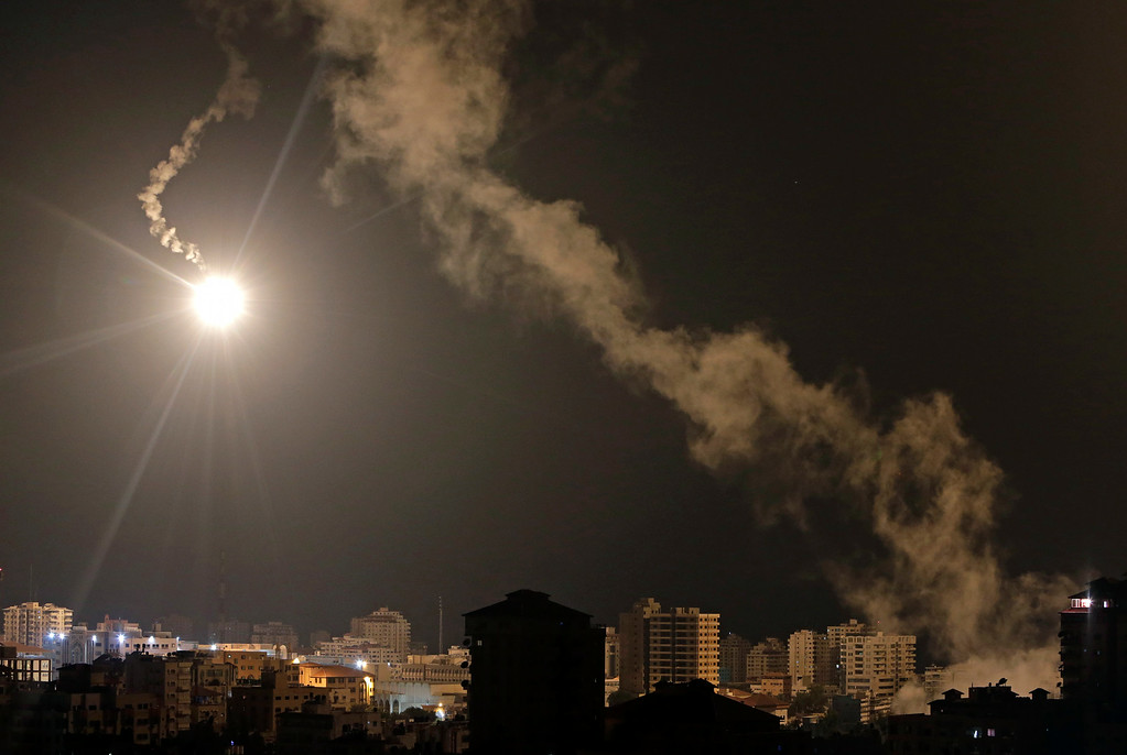 Description of . Israeli forces' flares light up the night sky  of Gaza City on early Tuesday, July 29, 2014. A truce between Israel and Hamas militants in Gaza remained elusive as diplomats sought to end the fighting at the start of the Eid al-Fitr holiday, marking the end of the Muslim holy month of Ramadan. (AP Photo/Khalil Hamra)