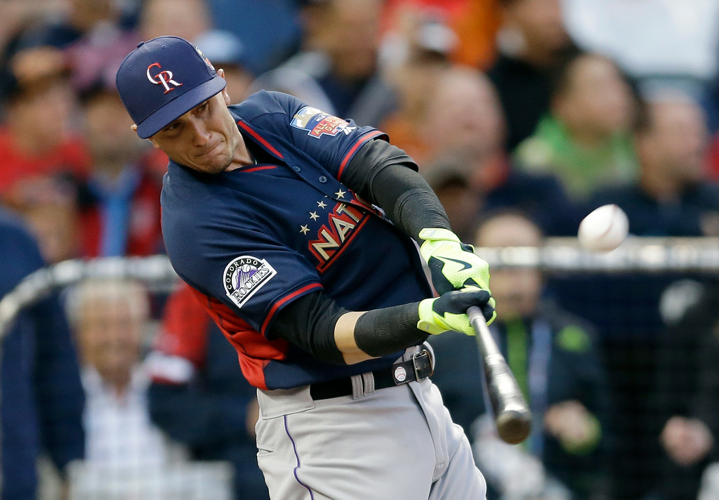 Description of . National League's Troy Tulowitzki, of the Colorado Rockies, hits during the MLB All-Star baseball Home Run Derby, Monday, July 14, 2014, in Minneapolis. (AP Photo/Jeff Roberson)