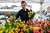 Paul Berg, visiting from Madison, Wisc., carefully picks out tulips for his sweetheart on the busiest flower sales day of the year at the Pike Place Market, Valentine's Day, Thursday, Feb. 14, 2013, in Seattle. At the peak of sales during the day, customers, nearly all men, lined-up as much as four deep along the 50-foot long table and at other vendor's inside the market as well. (AP Photo/Elaine Thompson)