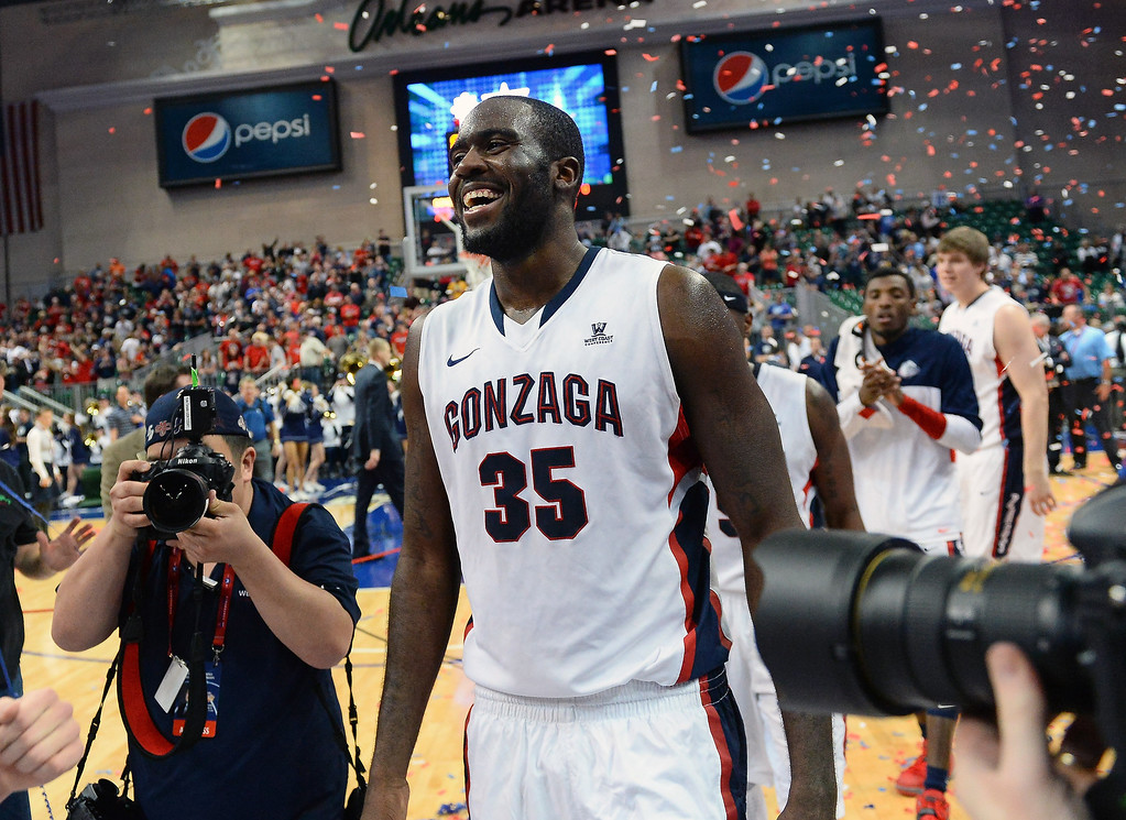 Description of . Sam Dower #35 of the Gonzaga Bulldogs celebrates on the court after winning the championship game of the West Coast Conference Basketball tournament 75-64 over the Brigham Young Cougars at the Orleans Arena on March 11, 2014 in Las Vegas, Nevada.  (Photo by Ethan Miller/Getty Images)
