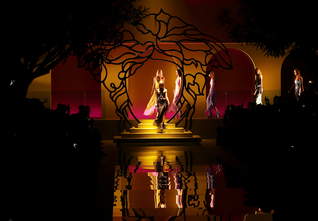 Description of . Models wear creations for Versace's women's Spring-Summer 2014 collection, part of the Milan Fashion Week, unveiled in Milan, Italy, Friday, Sept. 20, 2013. (AP Photo/Antonio Calanni)