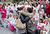 Two women kiss in front of people taking part in a demonstration called by the