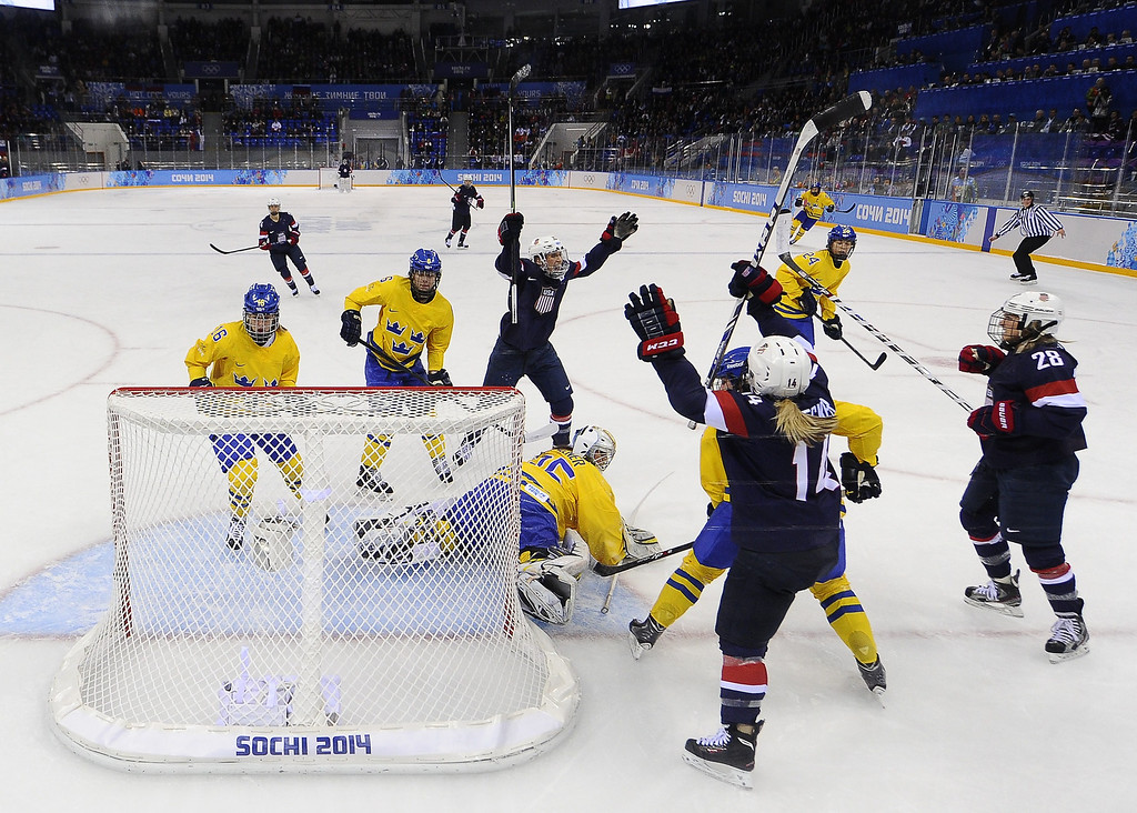Description of . US Amanda Kessel (R) celebrates with her teammates after scoring a goal during the Women's Ice Hockey Semifinals USA vs Sweden at the Shayba Arena during the Sochi Winter Olympics on February 17, 2014.     JONATHAN NACKSTRAND/AFP/Getty Images
