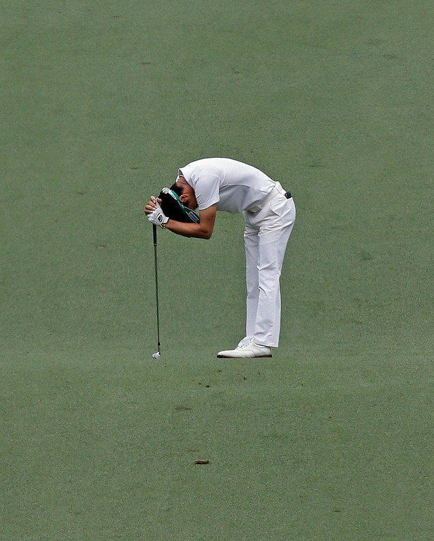Description of . Ryo Ishikawa, of Japan, reacts to his second shot on the seventh hole during the fourth round of the Masters golf tournament Sunday, April 14, 2013, in Augusta, Ga. (AP Photo/David J. Phillip)