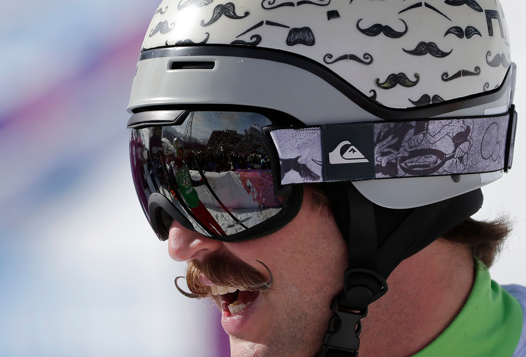 Description of . Moustaches are painted on the helmet of Slovenia's Filip Flisar during men's ski cross competition at the Rosa Khutor Extreme Park, at the 2014 Winter Olympics, Thursday, Feb. 20, 2014, in Krasnaya Polyana, Russia. (AP Photo/Andy Wong)