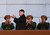 In this Feb. 16, 2012 file photo, new North Korean leader Kim Jong Un, second from left, applauds as he leaves the stands at Kumsusan Memorial Palace in Pyongyang after reviewing a parade of thousands of soldiers and commemorating the 70th birthday of the late Kim Jong Il. (AP Photo/David Guttenfelder, File)