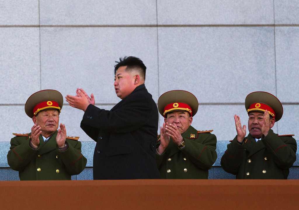 Description of . In this Feb. 16, 2012 file photo, new North Korean leader Kim Jong Un, second from left, applauds as he leaves the stands at Kumsusan Memorial Palace in Pyongyang after reviewing a parade of thousands of soldiers and commemorating the 70th birthday of the late Kim Jong Il. (AP Photo/David Guttenfelder, File)