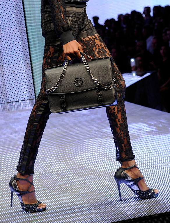 Description of . A model wears a creation for Philipp Plein women's Spring-Summer 2014 collection, part of the Milan Fashion Week, unveiled in Milan, Italy, Saturday, Sept. 21, 2013. (AP Photo/Giuseppe Aresu)
