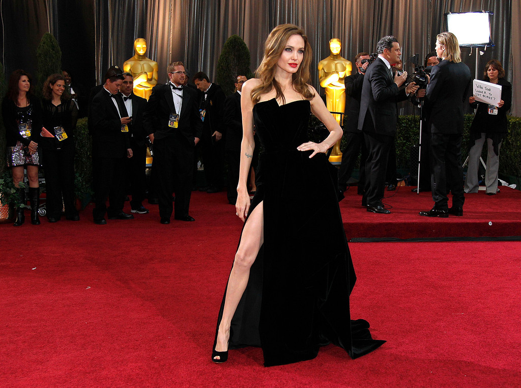 Description of . In this Feb. 26, 2012 file photo, Actress Angelina Jolie poses on the red carpet for photographers as she arrives the 84th Academy Awards in the Hollywood section of Los Angeles. (AP Photo/Amy Sancetta, File)