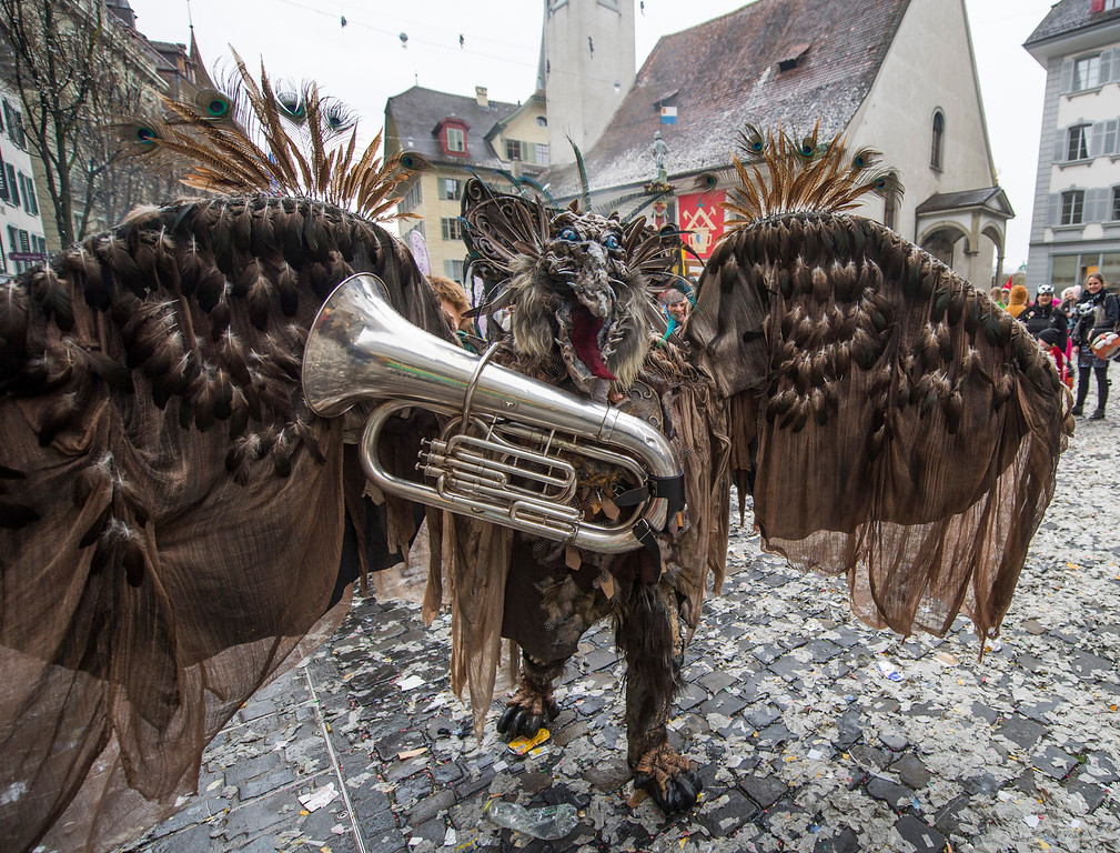 Description of . A reveler in a carnival costume attends the opening of the Lucerne carnival in Lucerne, Switzerland, on the so-called dirty Thursday, Feb. 27, 2014. (AP Photo/Keystone, Sigi Tischler)