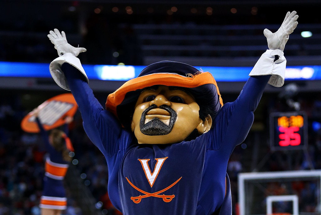 Description of . The Virginia Cavaliers mascot, CavMan, performs in their game against the Coastal Carolina Chanticleers during the Second Round of the 2014 NCAA Basketball Tournament at PNC Arena on March 21, 2014 in Raleigh, North Carolina.  (Photo by Streeter Lecka/Getty Images)