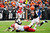 CLEVELAND, OH - DECEMBER 09: Wide receiver Dexter McCluster #22 of the Kansas City Chiefs jumps over cornerback Joe Haden #23 and tackle Eric Winston #74 of the Kansas City Chiefs while avoiding defensive end Jabaal Sheard #97 of the Cleveland Browns of the Cleveland Browns during the first half at Cleveland Browns Stadium on December 9, 2012 in Cleveland, Ohio. (Photo by Jason Miller/Getty Images)
