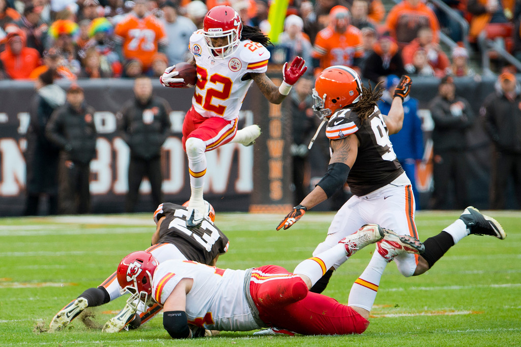 Description of . CLEVELAND, OH - DECEMBER 09: Wide receiver Dexter McCluster #22 of the Kansas City Chiefs jumps over cornerback Joe Haden #23 and tackle Eric Winston #74 of the Kansas City Chiefs while avoiding defensive end Jabaal Sheard #97 of the Cleveland Browns of the Cleveland Browns during the first half at Cleveland Browns Stadium on December 9, 2012 in Cleveland, Ohio. (Photo by Jason Miller/Getty Images)