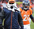 A member of the Broncos tries to keep warm on the sidelines during the third quarter.  The Denver Broncos vs Baltimore Ravens AFC Divisional playoff game at Sports Authority Field Saturday January 12, 2013. (Photo by Tim Rasmussen,/The Denver Post)