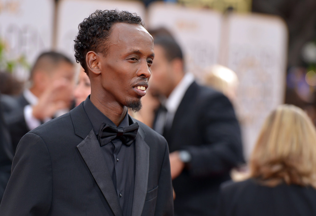 Description of . Barkhad Abdi arrives at the 71st annual Golden Globe Awards at the Beverly Hilton Hotel on Sunday, Jan. 12, 2014, in Beverly Hills, Calif. (Photo by John Shearer/Invision/AP)