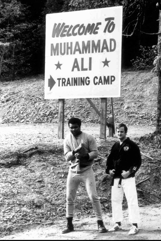 Description of . Boxer Muhammad Ali, left, stands with Karate instructor George Dillman in this 1971 file photo at Ali's training camp in Deer Lake, Pa. Dillman has purchased the six acre parcel that Ali called 'Fighters Haven' and is turning it into a bed and breakfast.(AP Photo/Kim Dillman)