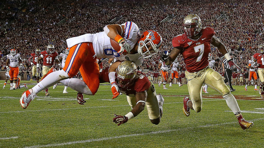 Description of . Trey Burton #8 of the Florida Gators is forced out of bounds by Terrence Brooks #31 of the Florida State Seminoles during a game  at Doak Campbell Stadium on November 24, 2012 in Tallahassee, Florida.  (Photo by Mike Ehrmann/Getty Images)