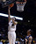 University of Colorado's Askia Booker goes for a layup over Gabe Rogers during a game against Northern Arizona on Friday, Dec. 21, at the Coors Event Center on the CU campus in Boulder.    (Jeremy Papasso/Daily Camera)