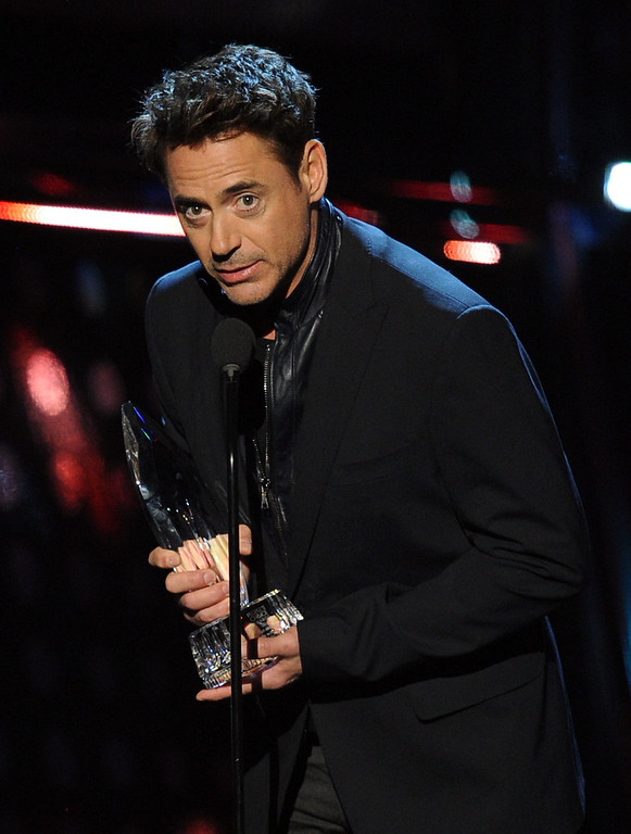 Description of . LOS ANGELES, CA - JANUARY 08:  Actor Robert Downey Jr. accepts the Favorite Action Movie Actor award onstage at The 40th Annual People's Choice Awards at Nokia Theatre L.A. Live on January 8, 2014 in Los Angeles, California.  (Photo by Kevin Winter/Getty Images)