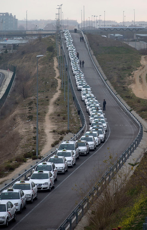 . A long line of taxis wait for passengers at Barajas international airport in Madrid, Spain, Monday Feb. 18, 2013.  Flights were disrupted Monday as workers at Iberia airlines began the first of 15-days of strikes to protest the company\'s plan to cut almost a fifth of its workforce. (AP Photo/Paul White)