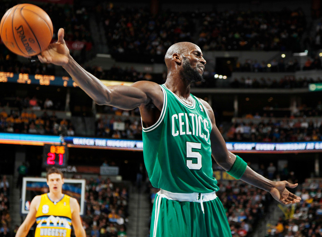 Description of . Boston Celtics forward Kevin Garnett reacts after being called for a foul against the Denver Nuggets in the third quarter of the Nuggets' 97-90 victory in an NBA basketball game in Denver on Tuesday, Feb. 19, 2013. (AP Photo/David Zalubowski)