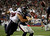 Houston Texans defensive end J.J. Watt knocks the ball away from New England Patriots running back Danny Woodhead (R) during the second half of their NFL football game in Foxborough, Massachusetts December 10, 2012.  The fumble was recovered by the Patriots for a touchdown. REUTERS/Jessica Rinaldi
