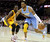 Denver Nuggets Andre Iguodala (R) drives to the basket past the defense of Cleveland Cavaliers Dion Waiters (L) during the first quarter of their NBA basketball game in Cleveland, February 9, 2013.   REUTERS/Aaron Josefczyk