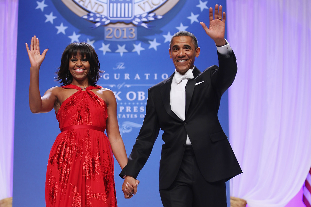 Description of . WASHINGTON, DC - JANUARY 21:  U.S. President Barack Obama and first lady Michelle Obama arrive for the Comander-in-Chief's Inaugural Ball at the Walter Washington Convention Center January 21, 2013 in Washington, DC. Obama was sworn-in for his second term of office earlier in the day.  (Photo by Chip Somodevilla/Getty Images)