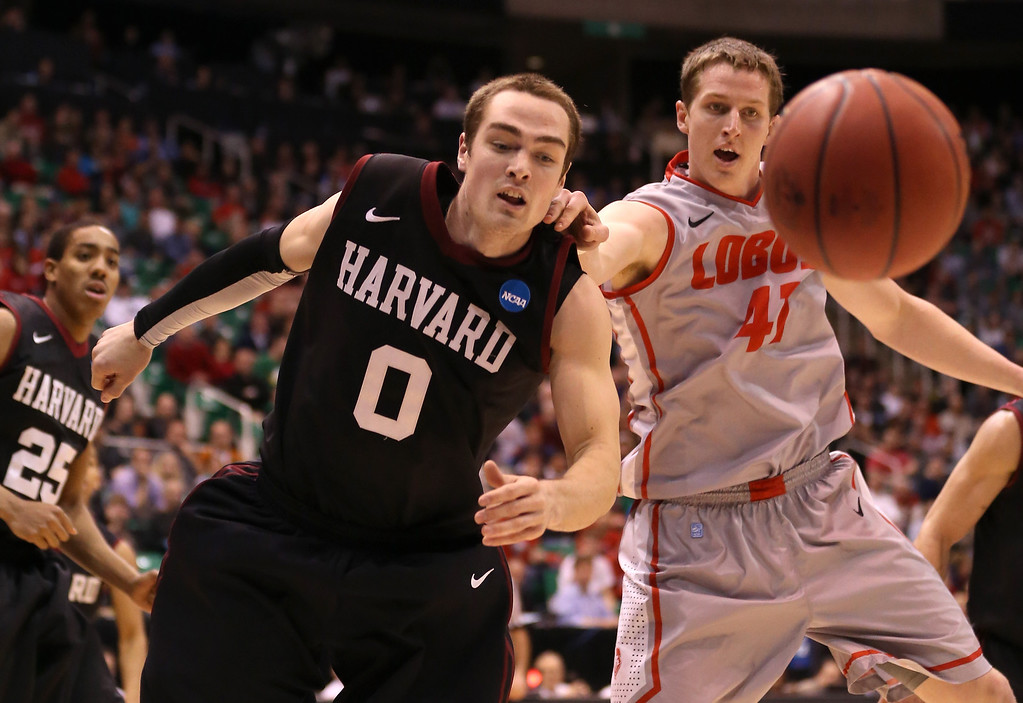 . SALT LAKE CITY, UT - MARCH 21:  Laurent Rivard #0 of the Harvard Crimson and Cameron Bairstow #41 of the New Mexico Lobos battle for a loose ball in the second half during the second round of the 2013 NCAA Men\'s Basketball Tournament at EnergySolutions Arena on March 21, 2013 in Salt Lake City, Utah.  (Photo by Streeter Lecka/Getty Images)