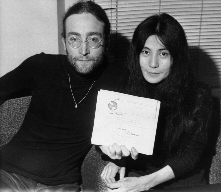 Description of . John Lennon and his wife Yoko Ono display a letter from Lennon to British Prime Minister Harold Wilson at the Beatles' Apple Records headquarters, Nov. 25, 1969.  The letter explains his reasons for returning his Order of the British Empire medal, including British support for the U.S.A.'s war in Vietnam and British involvement in Biafra and Nigeria.  (AP Photo)