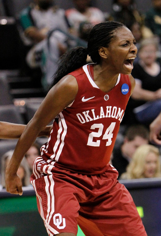 Description of . Oklahoma's guard Sharane Campbell (24) celebrates after a basket against Tennessee during the regional semifinal in the women's NCAA college basketball tournament in Oklahoma City  Sunday  March 31, 2013.  (AP Photo/Alonzo Adams)