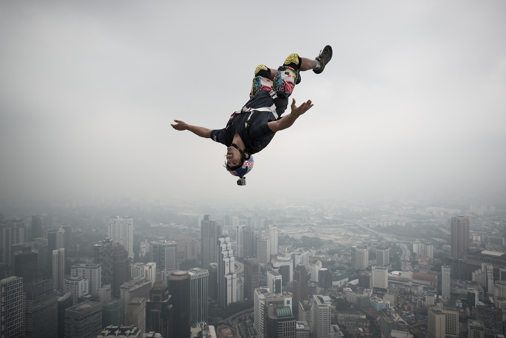 Description of . Base jumper Vincent Philippe Benjamin Reffet from France leaps from the 300-metres Open Deck of the Malaysia's landmark Kuala Lumpur Tower during the International Tower Jump in Kuala Lumpur on September 27, 2013. Some 103 professional base jumpers from 20 countries are taking part in the annual event. AFP PHOTO / MOHD RASFANMOHD RASFAN/AFP/Getty Images