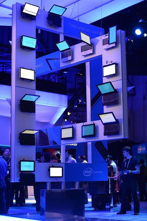 Description of . Laptop computers are seen at the Intel booth at the 2014 International CES in Las Vegas, Nevada, January 8, 2014.    AFP PHOTO / Robyn Beck/AFP/Getty Images