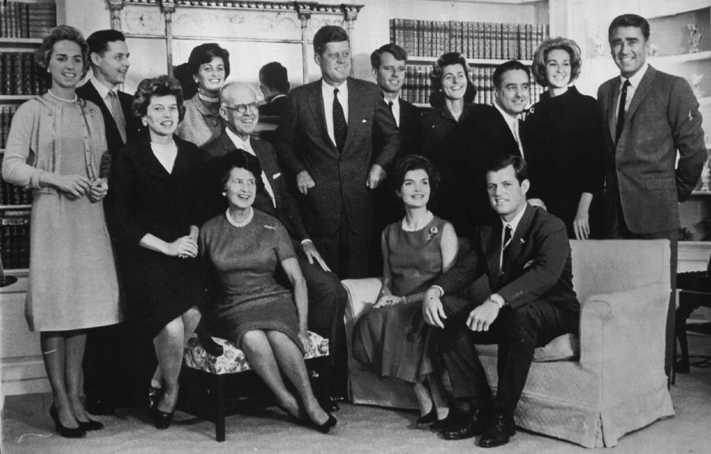 Description of . The Kennedy family gathers for a portrait on Nov. 9, 1960, in Hyannis, Mass., after John F. Kennedy was elected president.  Standing from left, are, Mrs. Bob Kennedy, Steve Smith and wife Jean Kennedy, President John F. Kennedy, Bob Kennedy, daughters Patricia Lawford, Sargent Shriver, Joseph P. Kennedy with wife seated in front of him, Mrs. John F. Kennedy and Ted Kennedy.  Denver Post file