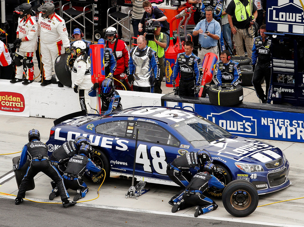 . Jimmie Johnson pits for tires and fuel during the NASCAR Daytona 500 Sprint Cup Series auto race at Daytona International Speedway, Sunday, Feb. 24, 2013, in Daytona Beach, Fla. (AP Photo/David Graham)