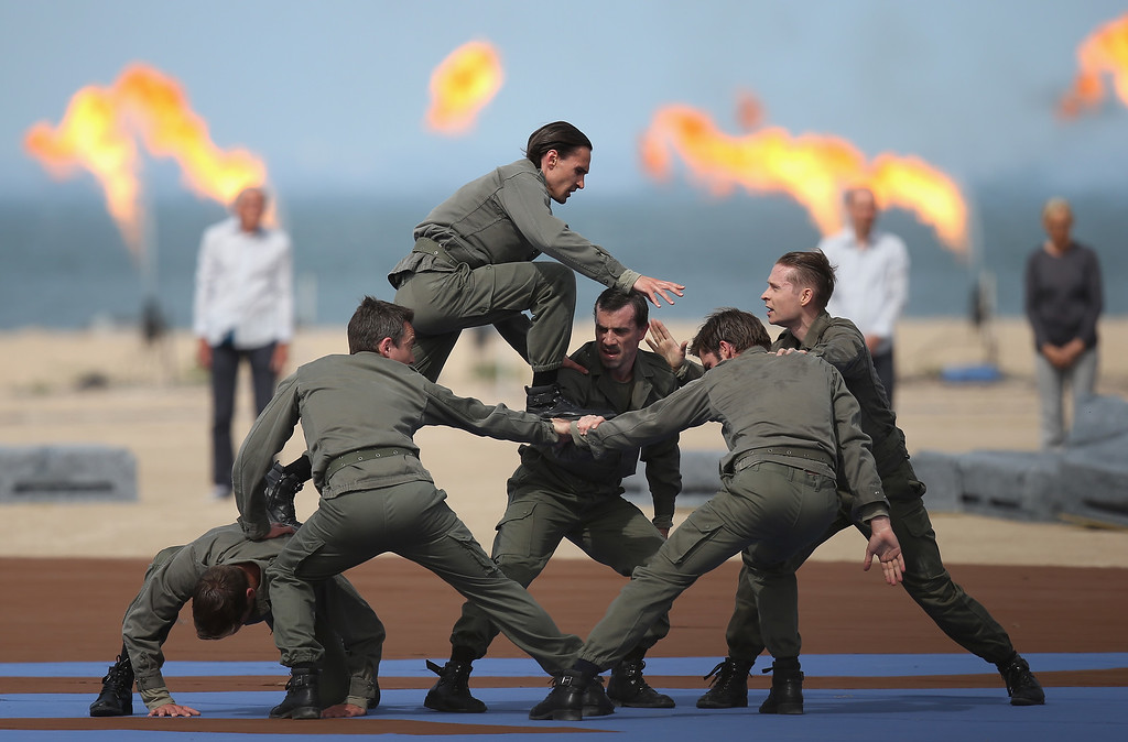 Description of . Dancers perform at the main international ceremony commemorating the 70th anniversary of the World War II D-Day invasion with 17 heads of state at Sword Beach on June 6, 2014 at Ouistreham, France.  (Photo by Sean Gallup/Getty Images)