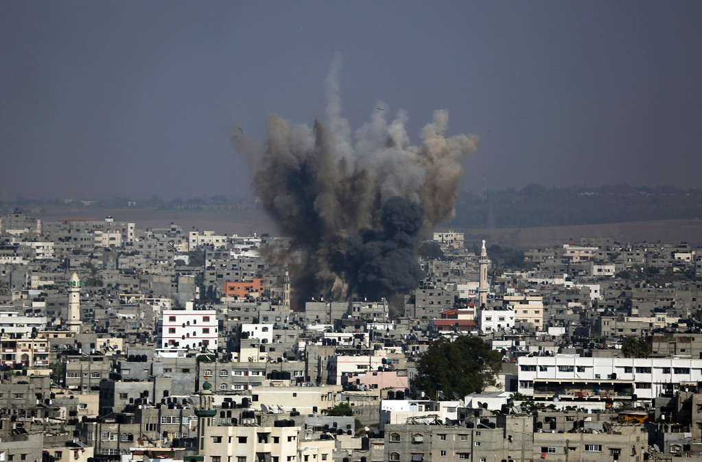 Description of . Smoke and debris from an Israeli strike rise over Gaza City, Tuesday, July 22, 2014, as Israeli airstrikes pummeled a wide range of locations along the coastal area and diplomatic efforts intensified to end the two-week war. (AP Photo/Hatem Moussa)