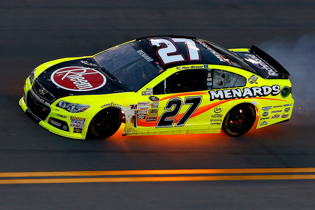 Description of . DAYTONA BEACH, FL - JULY 06:  Paul Menard, driver of the #27 Rheem / Menard\'s Chevrolet, has his car flame up underneath as he races during the NASCAR Sprint Cup Series Coke Zero 400 at Daytona International Speedway on July 6, 2013 in Daytona Beach, Florida.  (Photo by Scott Halleran/Getty Images)