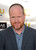 Actor Joss Whedon arrives at the 18th Annual Critics' Choice Movie Awards at Barker Hangar on January 10, 2013 in Santa Monica, California.  (Photo by Frazer Harrison/Getty Images)