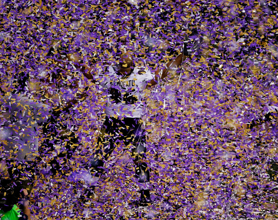Description of . Baltimore Ravens nose tackle Ma\'ake Kemoeatu (96) celebrates after the NFL Super Bowl XLVII football game against the San Francisco 49ers, Sunday, Feb. 3, 2013, in New Orleans. The Ravens won 34-31. (AP Photo/Charlie Riedel)