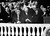 U.S. President Dwight Eisenhower acknowledges applause as he stands on the Capitol inaugural stand with first lady Mamie Eisenhower, left, in Washington, D.C., Jan. 21, 1957. Vice President Richard Nixon is at far right, with his wife, Pat, second from right. (AP Photo)