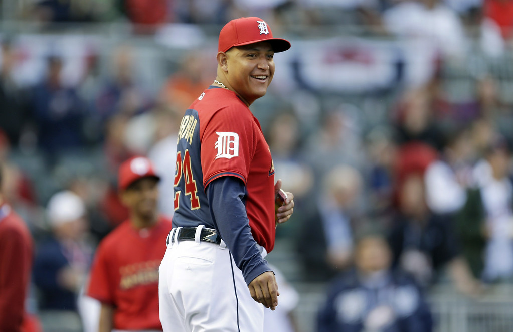 Description of . American League infielder Miguel Cabrera, of the Detroit Tigers, looks on during a rain delay in the MLB All-Star baseball Home Run Derby, Monday, July 14, 2014, in Minneapolis. (AP Photo/Jeff Roberson)