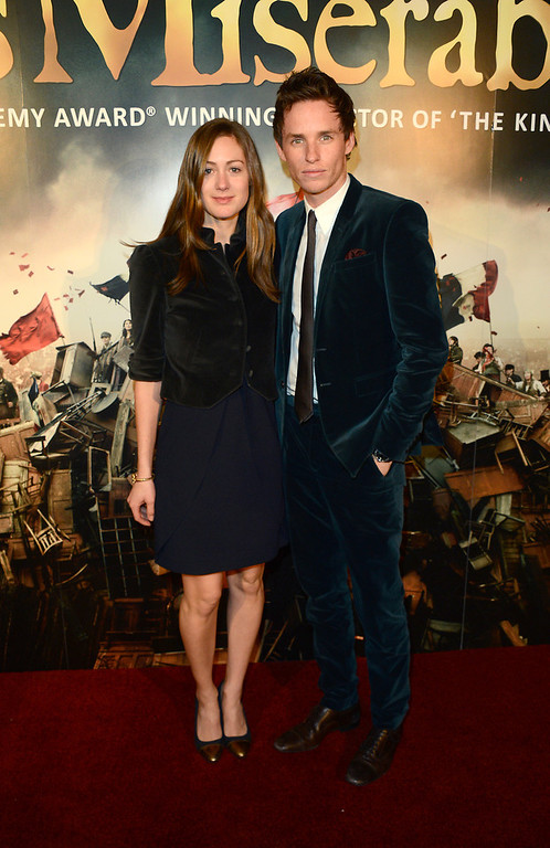 Description of . Eddie Redmayne and Hannah Bagshawe pose for photographers as they arrive at the after party for the premiere of Les Miserables at the Roundhouse, London, Wednesday, Dec. 5, 2012. (Photo by Jon Furniss/Invision/AP)