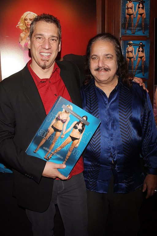 Description of . Photographer Michael Grecco (L) and adult film star Ron Jeremy attend a party to celebrate Grecco's new book
