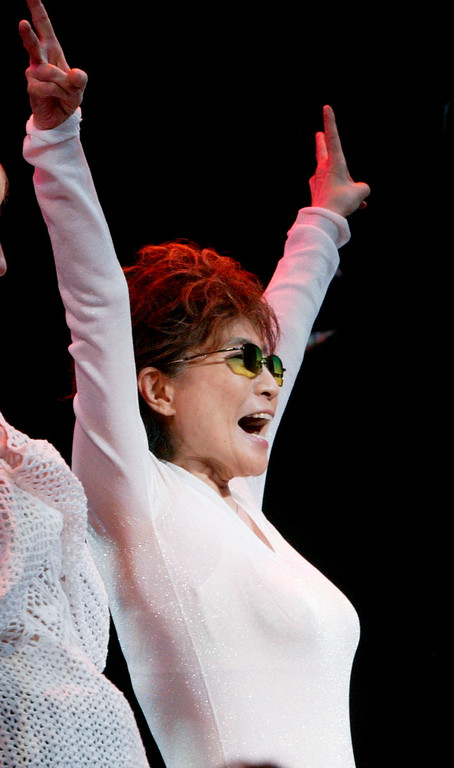 Description of . Yoko Ono celebrates during the curtain call for 'Lennon,' a new Broadway musical about the life of her husband John Lennon, Sunday, Aug. 14, 2005, in New York.  (AP Photo/Diane Bondareff)
