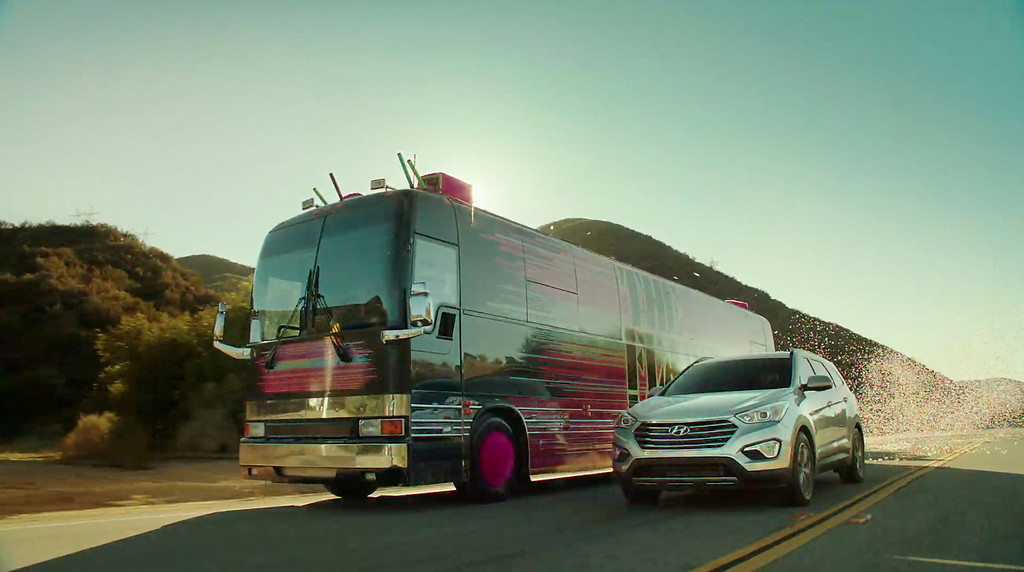 Description of . This screen shot provided by Hyundai shows the Super Bowl advertisement by Hyundai Motor Group's Kia. In the advertisment, Kia invents a fanciful way that babies are made, blasting in from a baby planet in its