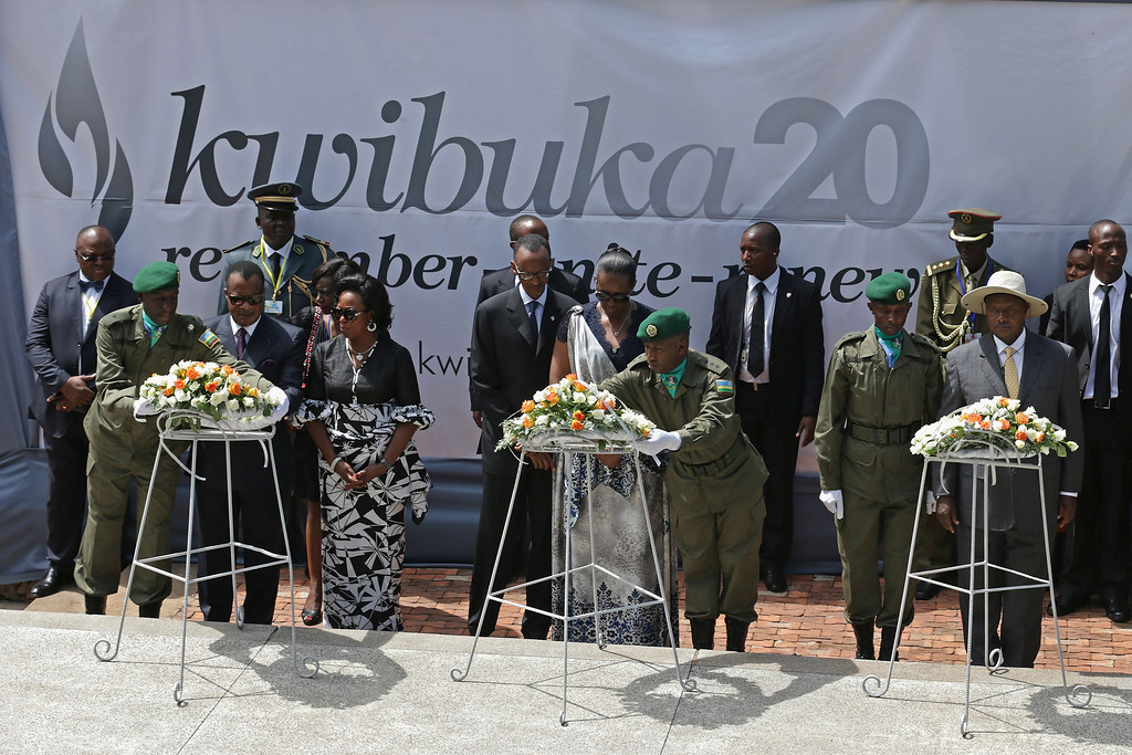 Description of . (L-R) Congo-Brazzaville President Denis Sassou Nguesso and first lady Antoinette Sassou-Nguesso, Rwanda President Paul Kagame and first lady Jeannette Kagame and Uganda President Yoweri Museveni participate in a wreath-laying ceremony at a tomb that holds 250,000 victims of the 1994 genocide during a ceremony at the Kigali Genocide Memorial Center on April 7, 2014 in Kigali, Rwanda.  (Photo by Chip Somodevilla/Getty Images)