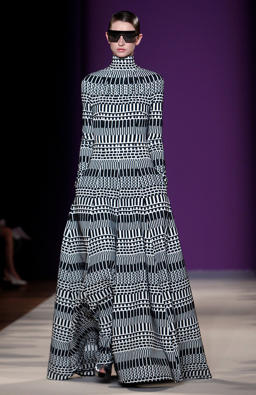 Description of . A model wears a creation for Talbot Runhof's ready-to-wear Spring/Summer 2014 fashion collection, presented in Paris, Friday, Sept.27, 2013. (AP Photo/Thibault Camus)