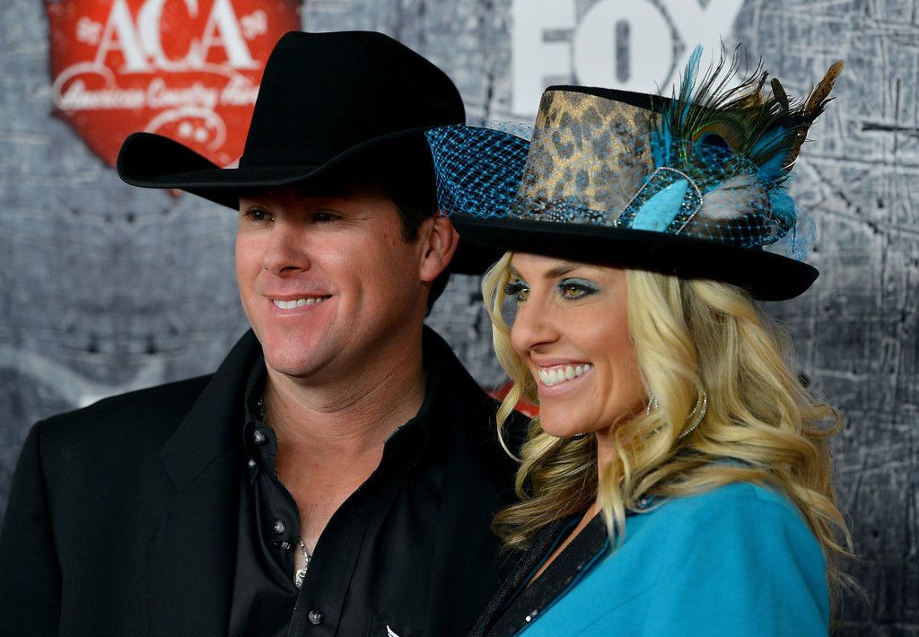 Description of . LAS VEGAS, NV - DECEMBER 10:  Rodeo champion Trevor Brazile (L) and his wife Shada Brazile arrive at the 2012 American Country Awards at the Mandalay Bay Events Center on December 10, 2012 in Las Vegas, Nevada.  (Photo by Frazer Harrison/Getty Images)